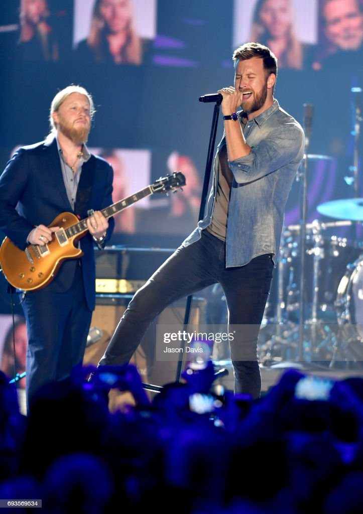 Guitarist Derek Trucks (L) and singer-songwriter Charles Kelley (R) performs onstage the 2017 CMT Music Awards at the Music City Center on June 7, 2017 in Nashville, Tennessee.