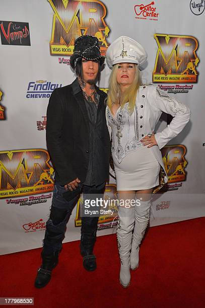 Guitarist Dj Ashba and Sally Steele arrive at the Vegas Rocks Magazine Music Awards 2013 at the Joint inside the Hard Rock Hotel Casino on August 25...