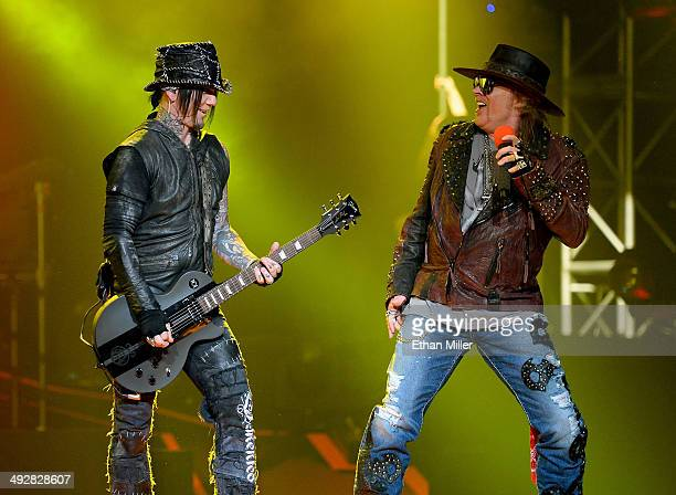 Guitarist Dj Ashba and singer Axl Rose of Guns N' Roses perform at The Joint inside the Hard Rock Hotel Casino during the opening night of the band's...