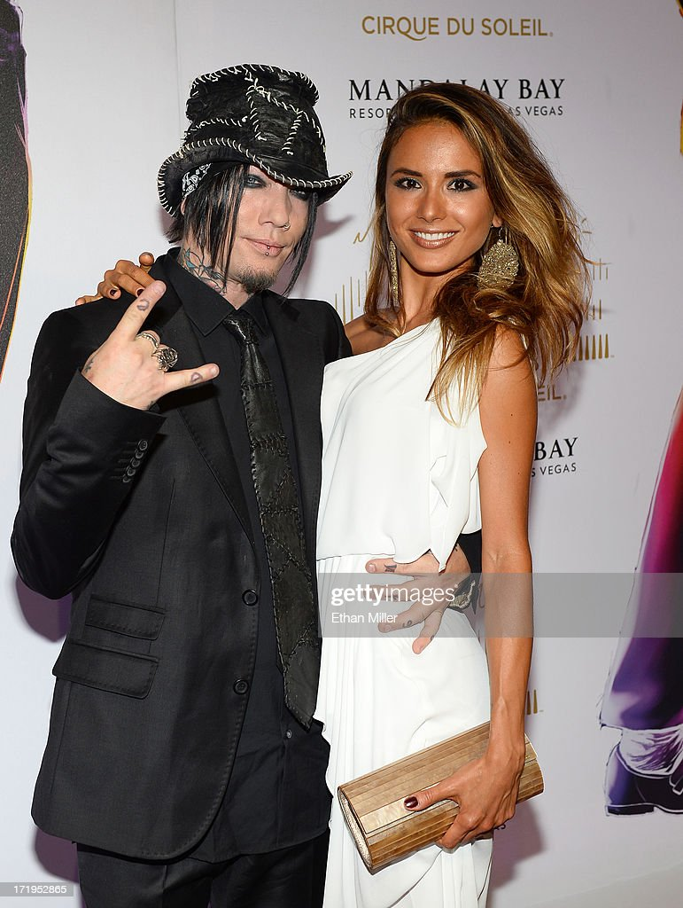 Guitarist Dj Ashba of Guns N' Roses and Nathalia Henao arrive at the world premiere of 'Michael Jackson ONE by Cirque du Soleil' at THEhotel at Mandalay Bay on June 29, 2013 in Las Vegas, Nevada.