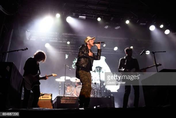 Guitarist Drew Brown singer Ryan Tedder and bassist Brent Kutzle of OneRepublic perform during the Spring Fling concert at the Red Rock Resort on...