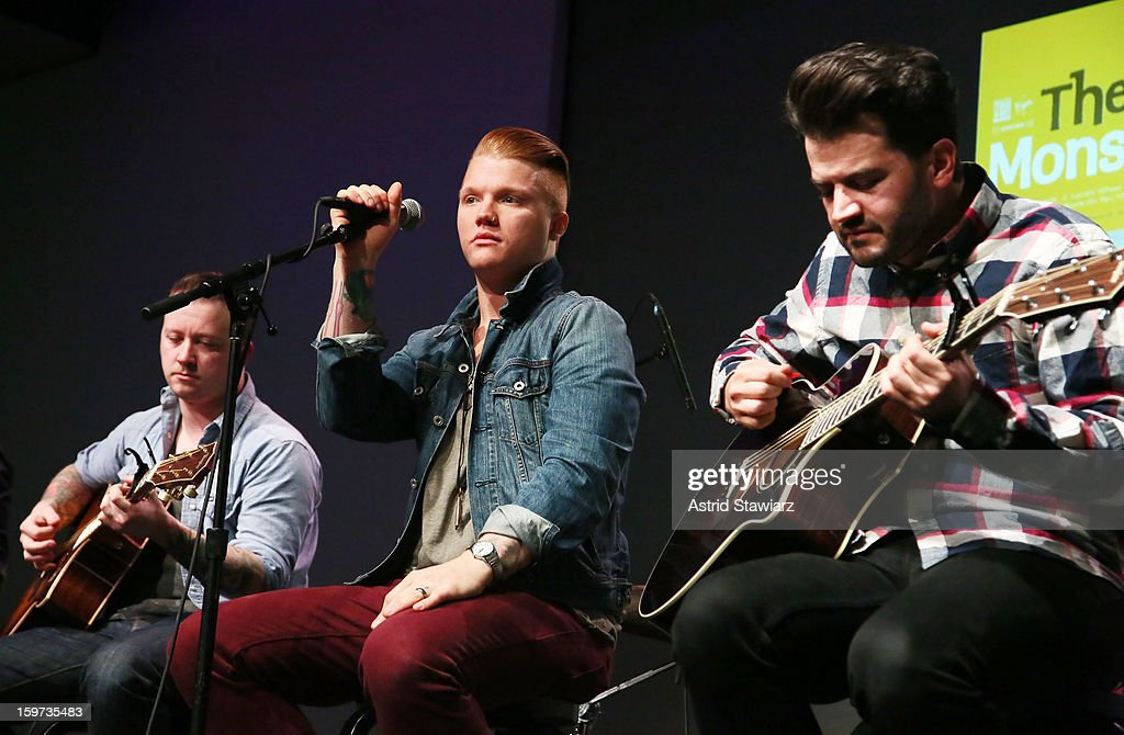 Guitarist Dusty Redmon, singer <a gi-track='captionPersonalityLinkClicked' href=/galleries/search?phrase=Aaron+Gillespie&family=editorial&specificpeople=538897 ng-click='$event.stopPropagation()'>Aaron Gillespie</a> and guitarist Jay Vilardi of The Almost perform during Apple Store Soho Presents: The Almost at Apple Store Soho on January 19, 2013 in New York City.