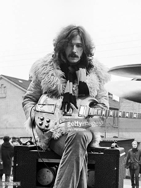 Guitarist Eric Clapton of British rock supergroup Cream sitting on an amplifier on the set of the Danish film 'On A Saturday Night' Vognmandsmarken...