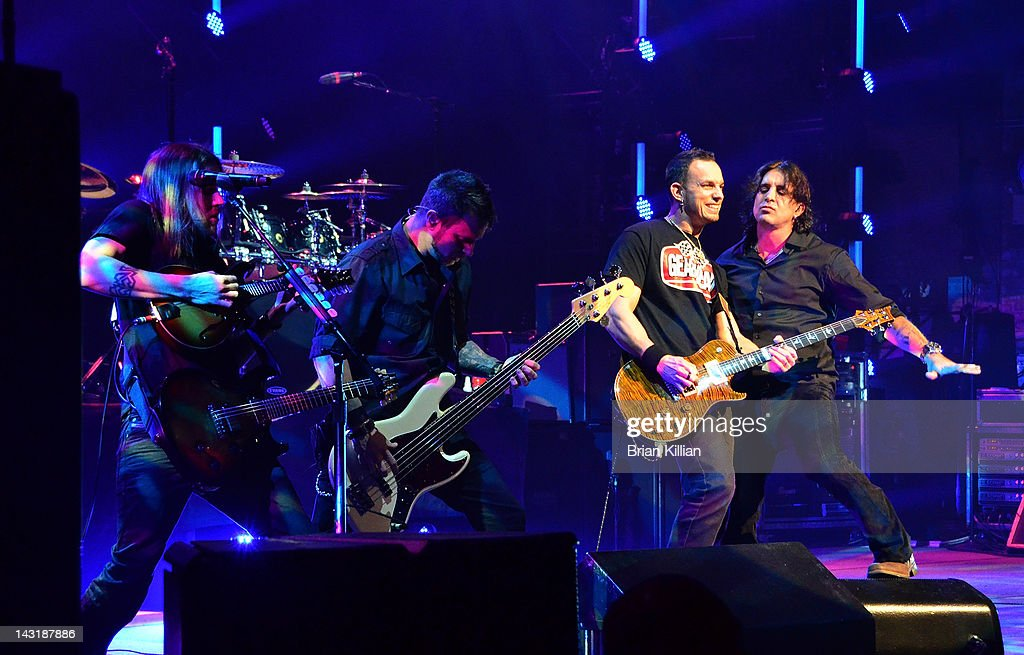 Guitarist Eric Friedman, bass player Brian Marshall, singer Scott Stapp, and guitarist Mark Tremonti of the band Creed perform at the Beacon Theatre on April 20, 2012 in New York City.