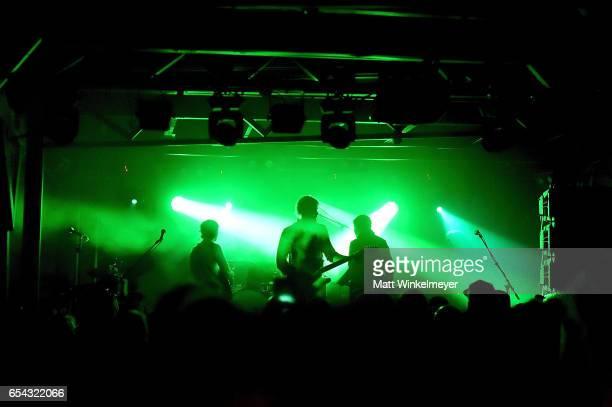 Guitarist Eric Harvey singer/guitarist Britt Daniel drummer Jim Eno and bassist Rob Pope of Spoon perform during the Spoon SXSW Residency 2017 SXSW...