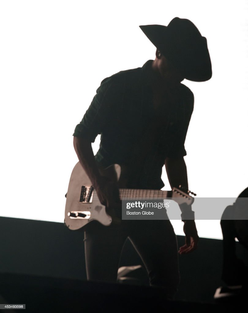 A guitarist for Dierks Bentley walking on stage before their concert at Gillette Stadium on Sunday, August 10, 2014.
