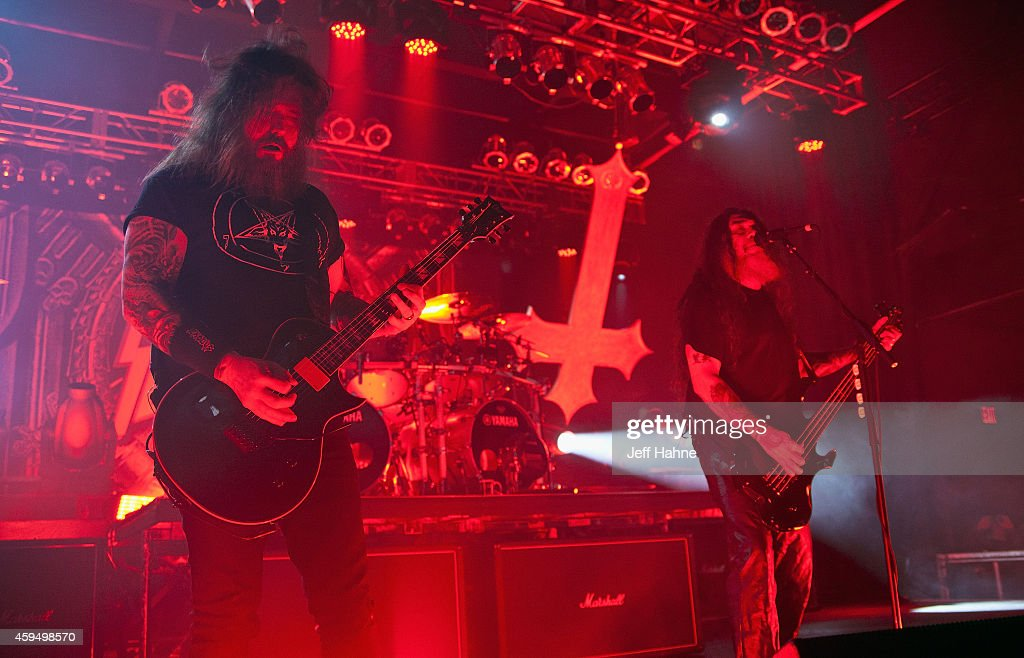 Guitarist <a gi-track='captionPersonalityLinkClicked' href=/galleries/search?phrase=Gary+Holt+-+Musician&family=editorial&specificpeople=15005307 ng-click='$event.stopPropagation()'>Gary Holt</a> and bassist/singer <a gi-track='captionPersonalityLinkClicked' href=/galleries/search?phrase=Tom+Araya&family=editorial&specificpeople=235893 ng-click='$event.stopPropagation()'>Tom Araya</a> of Slayer perform at The Fillmore Charlotte on November 23, 2014 in Charlotte, North Carolina.