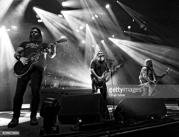 LR Guitarist Gary Holt bassist/singer Tom Araya and guitarist Kerry King of Slayer perform at The Joint inside the Hard Rock Hotel Casino on August 4...