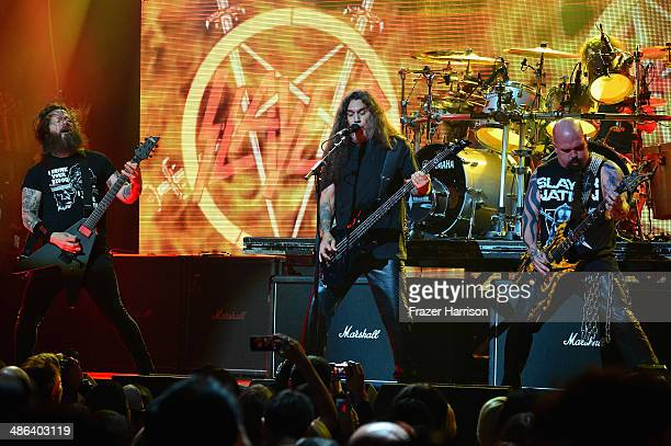 Guitarist Gary Wayne Holt bassist Tom Araya and guitarist Kerry King of Slayer performs onstage at the 2014 Revolver Golden Gods Awards at Club Nokia...