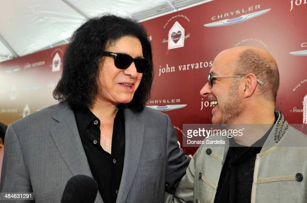 Guitarist Gene Simmons and designer John Varvatos arrive at the John Varvatos 11th Annual Stuart House Benefit at John Varvatos Boutique on April 13...