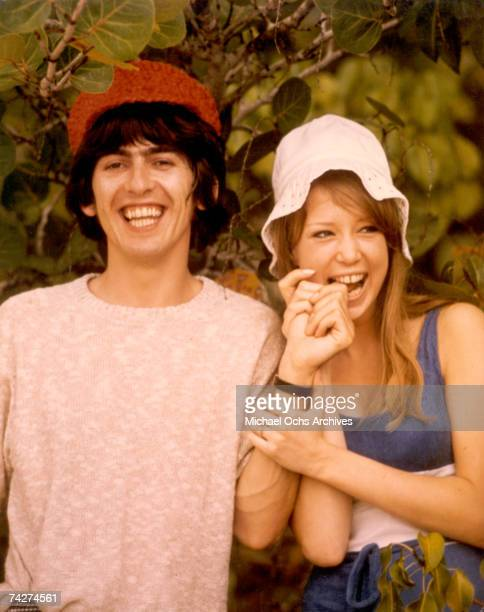 Guitarist George Harrison of the rock and roll band 'The Beatles' poses for a portrait with his girlfriend Pattie Boyd in circa 1966