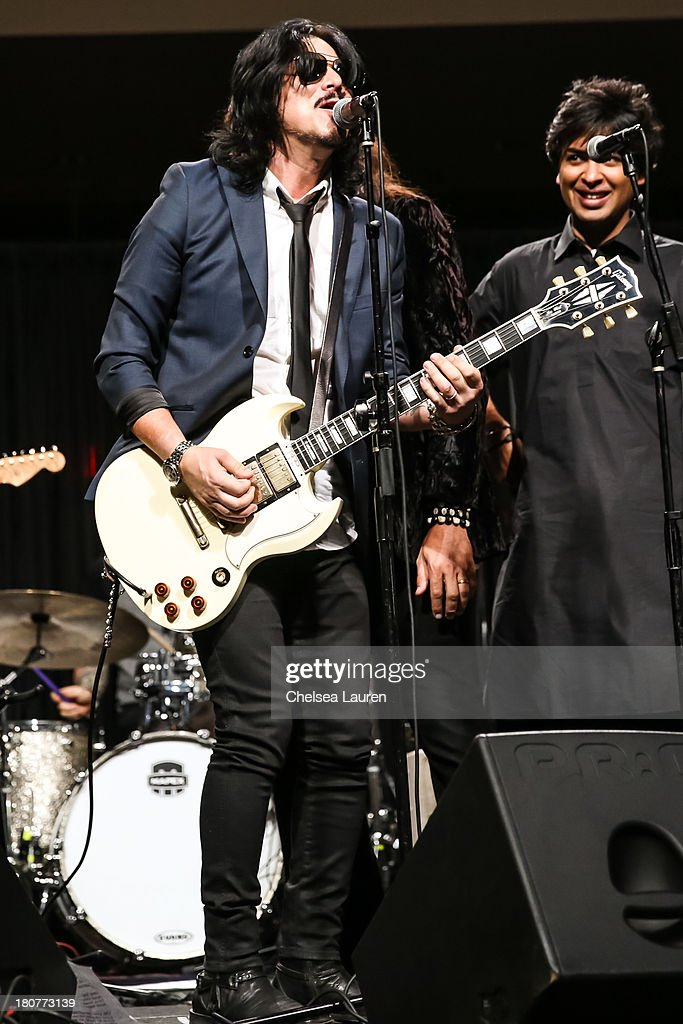 Guitarist <a gi-track='captionPersonalityLinkClicked' href=/galleries/search?phrase=Gilby+Clarke&family=editorial&specificpeople=614488 ng-click='$event.stopPropagation()'>Gilby Clarke</a> performs at Adopt the Arts' Peace Through Music celebrity gala at Loews Hollywood Hotel on September 15, 2013 in Hollywood, California.