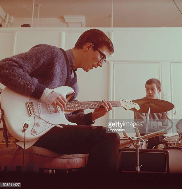 Guitarist Hank Marvin and drummer Brian Bennett from English group The Shadows rehearse backstage in England in 1963