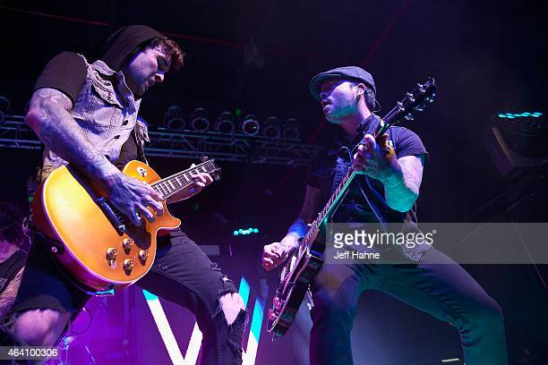 Guitarist Jack Fowler and guitarist Nick Martin of Sleeping with Sirens performs at The Fillmore Charlotte on February 21 2015 in Charlotte North...