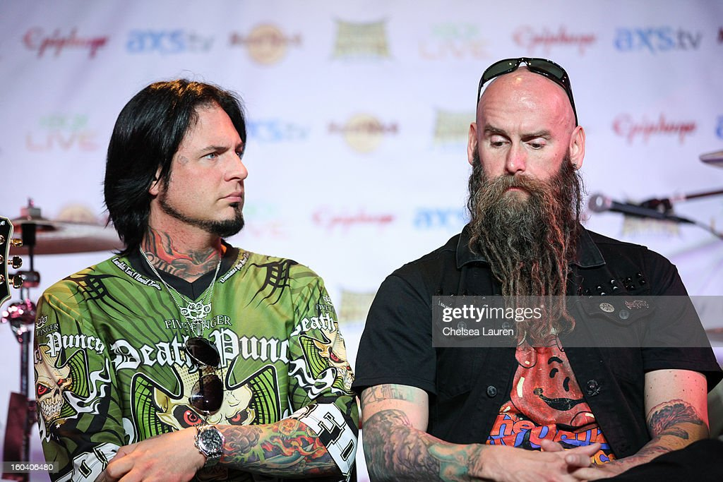 Guitarist Jason Hook (L) and bassist Chris Kael of Five Finger Death Punch attend the Revolver Golden Gods Awards press conference at Hard Rock Cafe - Hollywood on January 30, 2013 in Hollywood, California.