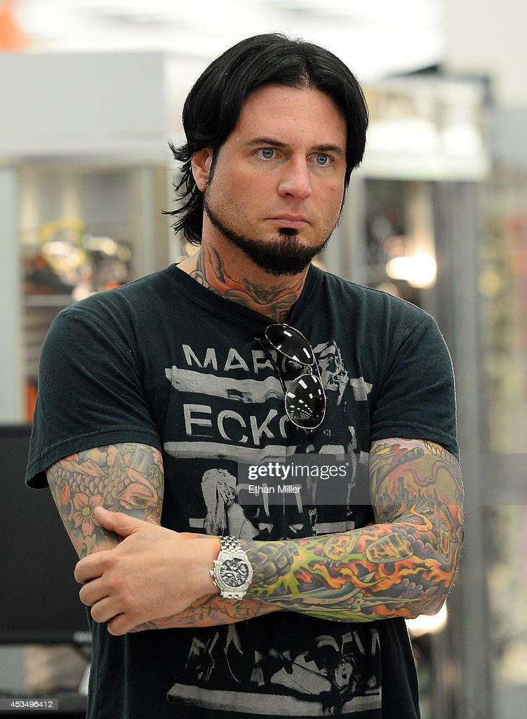 Guitarist Jason Hook of Five Finger Death Punch watches the group's new video being shown at Nellis Air Force Base as the band highlights its campaign to raise awareness about veterans suffering from post-traumatic stress disorder (PTSD), in part by launching the video 'Wrong Side of Heaven,' that deals with the subject on August 11, 2014 in Las Vegas, Nevada.