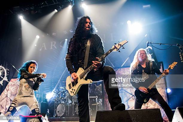 Guitarist Jeff Loomis bassist Sharlee D'Angelo and vocalist Alissa WhiteGluz of Arch Enemy perform during The Summer Slaughter Tour at The Regency...
