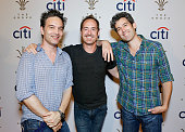 Guitarist Jeff Russo singer/guitarist Emerson Hart and bass guitarist Dan Lavery pose for photo at Citi Presents Plain White T's at the Grove's 2016...