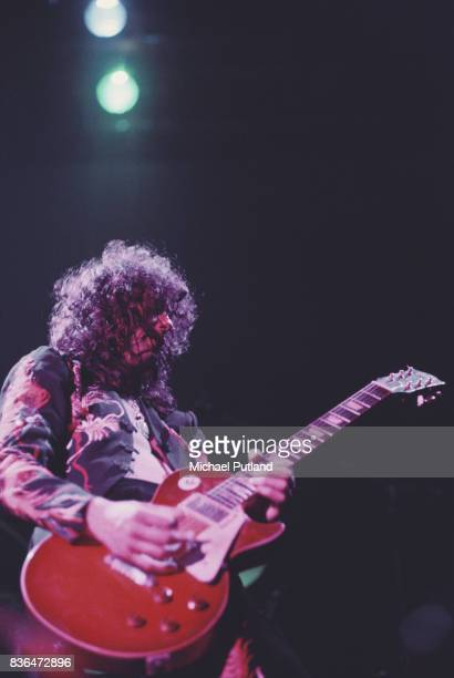 Guitarist Jimmy Page of British rock band Led Zeppelin performs on stage at Earl's Court in London England in May 1975