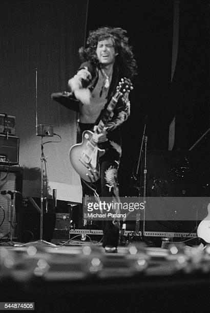Guitarist Jimmy Page performing with British heavy rock group Led Zeppelin at Earl's Court London May 1975 On the left is Page's theremin The band...