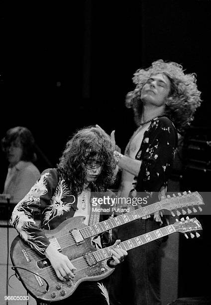 Guitarist Jimmy Page plays a doublenecked guitar during a concert by English rock group Led Zeppelin at Earls Court Arena in London May 1975 Behind...