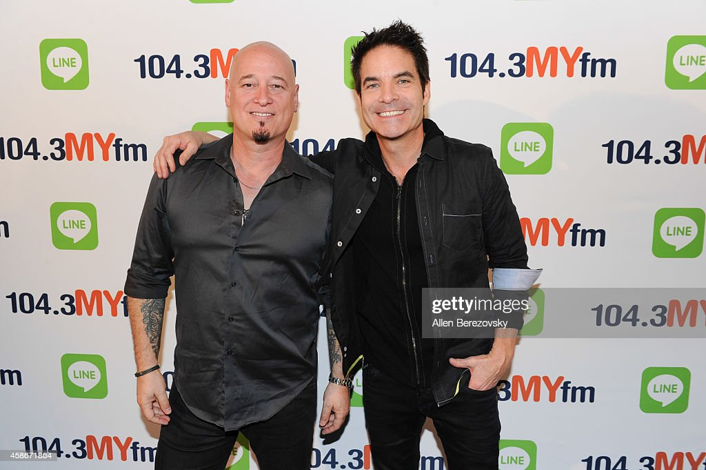 Guitarist <a gi-track='captionPersonalityLinkClicked' href=/galleries/search?phrase=Jimmy+Stafford&family=editorial&specificpeople=750178 ng-click='$event.stopPropagation()'>Jimmy Stafford</a> (L) and lead singer Pat Monahan of the rock band <a gi-track='captionPersonalityLinkClicked' href=/galleries/search?phrase=Train+-+Band&family=editorial&specificpeople=7346356 ng-click='$event.stopPropagation()'>Train</a> pose back stage during 104.3 MYFM's My Big Night Out concert series at Honda Center on November 8, 2014 in Anaheim, California.