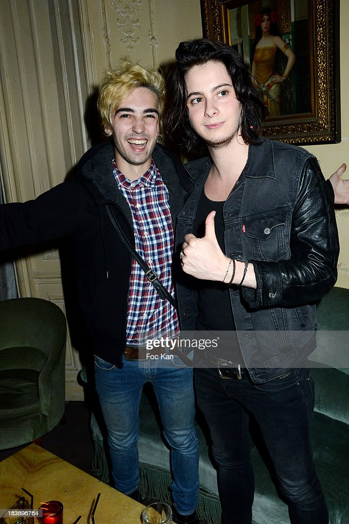 Guitarist JLPS and Drummer Cyprian from Air Bag One Band attend the the Plastiscines private concert hosted by MTV Pulse at The Carmen Club on October 9, 2013 in Paris, France.