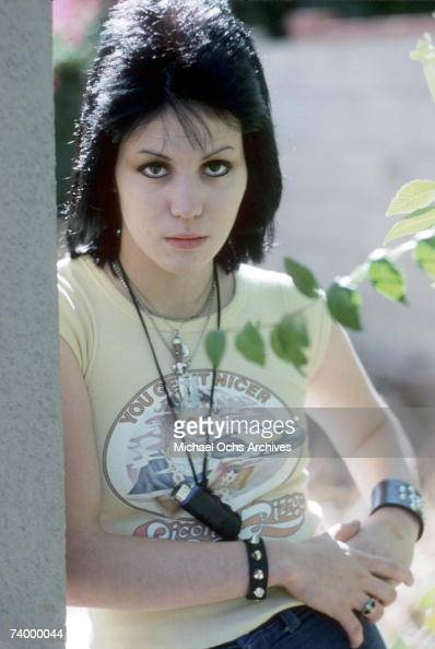 Guitarist Joan Jett of the rock band 'The Runaways' poses for a portrait by her family´s home in Canoga Park just outside Los Angeles CA in December...