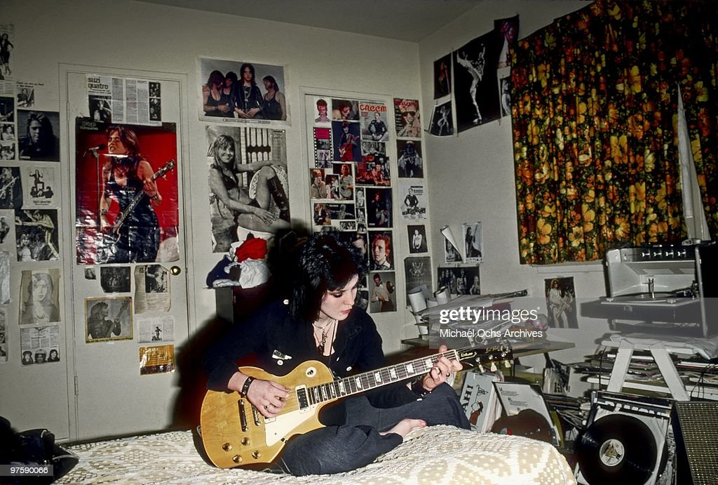 Guitarist Joan Jett of the rock band 'The Runaways' poses for a portrait in her bedroom at her family's home in Canoga Park just outside Los Angeles, CA in 1977.