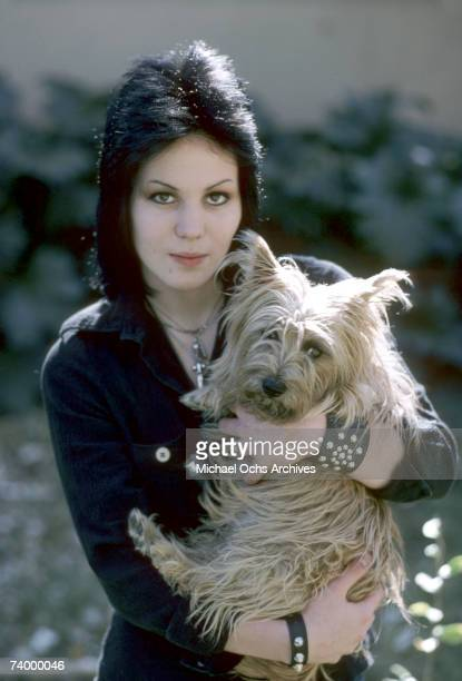Guitarist Joan Jett of the rock band 'The Runaways' poses for a portrait withe her dog 'Meg' by her family´s home in Canoga Park just outside Los...