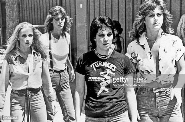 Guitarist Joan Jett of the rock band 'The Runaways' walks and rocks in 1977