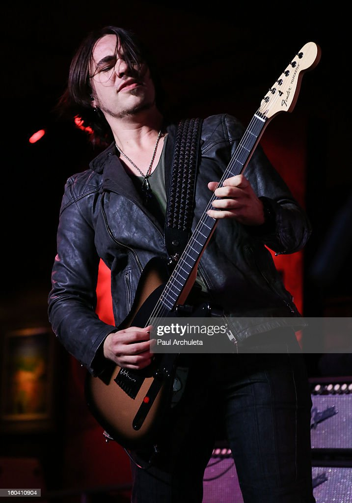 Guitarist Joe Hottinger of the Metal Band Halestorm performs at the 5th annual Revolver Golden Gods Awards nominee announcements at the Hard Rock Cafe Hollywood on January 30, 2013 in Hollywood, California.
