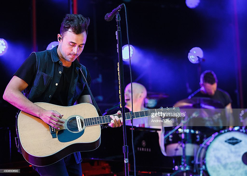 Guitarist <a gi-track='captionPersonalityLinkClicked' href=/galleries/search?phrase=Joe+King+-+Guitarist&family=editorial&specificpeople=15305707 ng-click='$event.stopPropagation()'>Joe King</a> of the Fray performs on stage at Malkin Bowl at Stanley Park on June 18, 2014 in Vancouver, Canada.