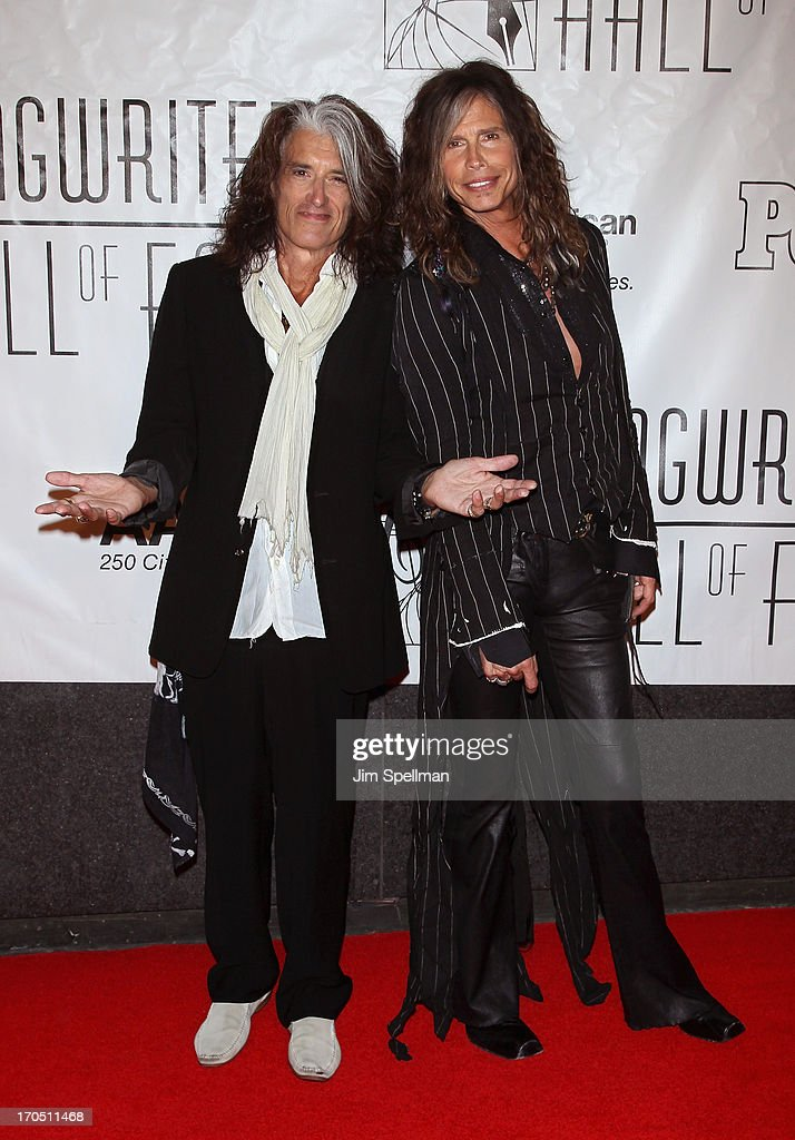 Guitarist Joe Perry and singer Steven Tyler attend the 2013 Songwriters Hall Of Fame Gala at Marriott Marquis Hotel on June 13, 2013 in New York City.