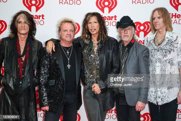 Guitarist Joe Perry drummer Joey Kramer vocalist Steven Tyler guitarist Brad Whitford and bassist Tom Hamilton of Aerosmith arrive at iHeartRadio...