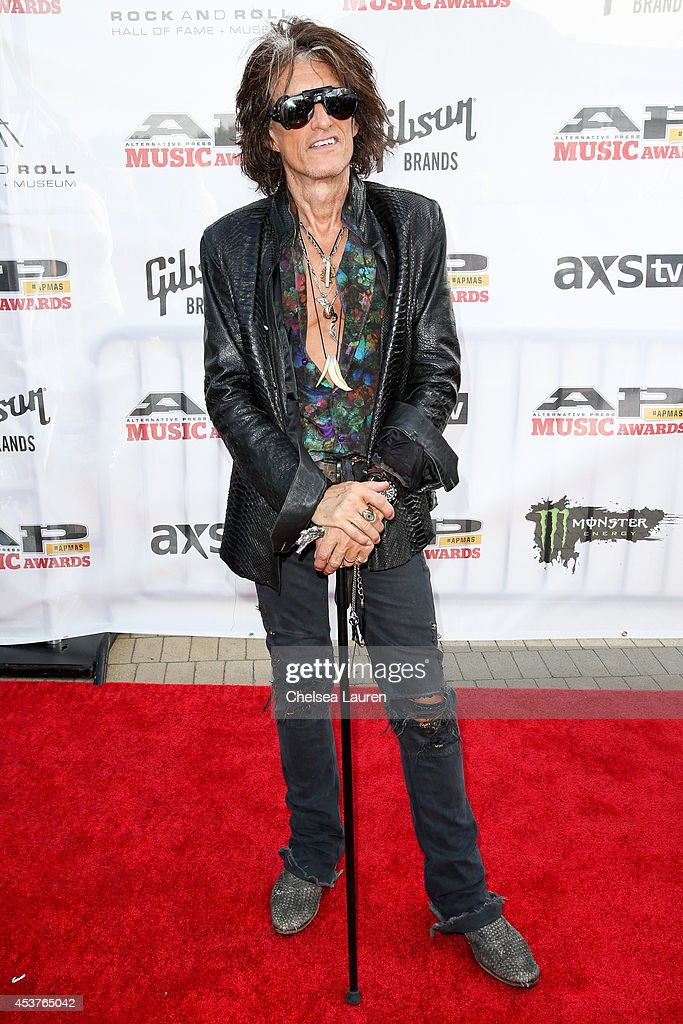 Guitarist <a gi-track='captionPersonalityLinkClicked' href=/galleries/search?phrase=Joe+Perry+-+Musician&family=editorial&specificpeople=13600677 ng-click='$event.stopPropagation()'>Joe Perry</a> of Aerosmith attends the 2014 Gibson Brands AP Music Awards at the Rock and Roll Hall of Fame and Museum on July 21, 2014 in Cleveland, Ohio.