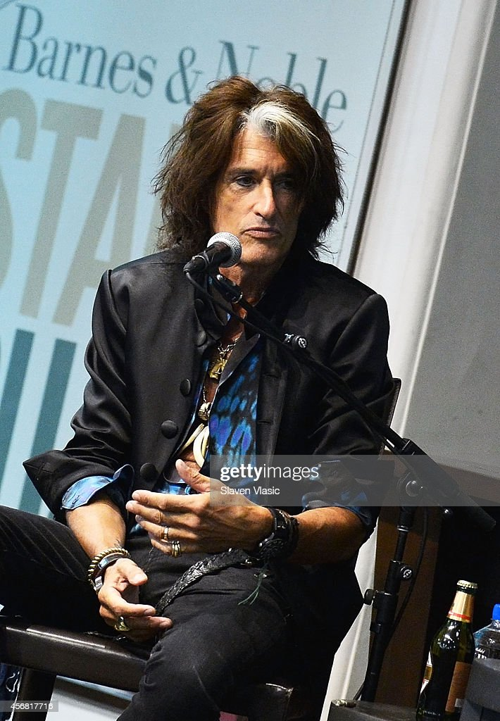 Guitarist Joe Perry of Aerosmith promotes his book 'Rocks: My life in and out of Aerosmith' during conversation with Eddie Trunk at Barnes & Noble Union Square on October 7, 2014 in New York City.