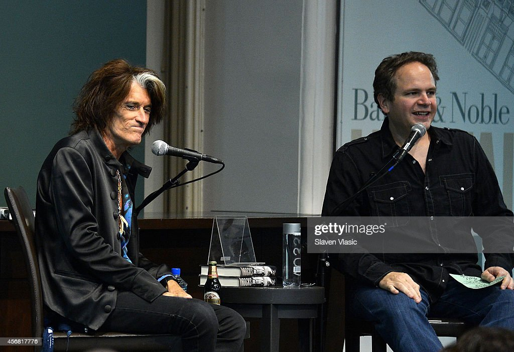 Guitarist Joe Perry (L) of Aerosmith promotes his book 'Rocks: My life in and out of Aerosmith' during conversation with Eddie Trunk (R) at Barnes & Noble Union Square on October 7, 2014 in New York City.