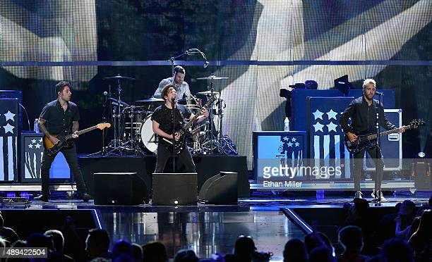 Guitarist Joe Trohman frontman Patrick Stump drummer Andy Hurley and bassist Pete Wentz of Fall Out Boy perform at the 2015 iHeartRadio Music...