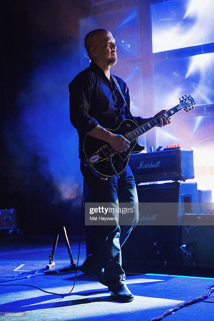 Guitarist Joey Santiago of the Pixies performs on stage at The Paramount Theater on February 18, 2014 in Seattle, Washington.