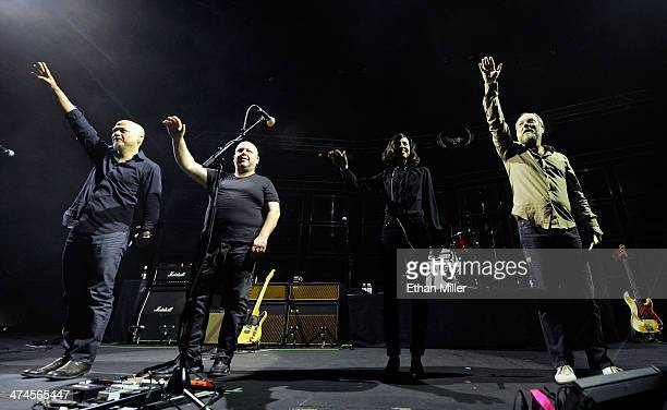 Guitarist Joey Santiago singer/guitarist Black Francis bassist Paz Lenchantin and drummer David Lovering wave as the band Pixies takes the stage at...