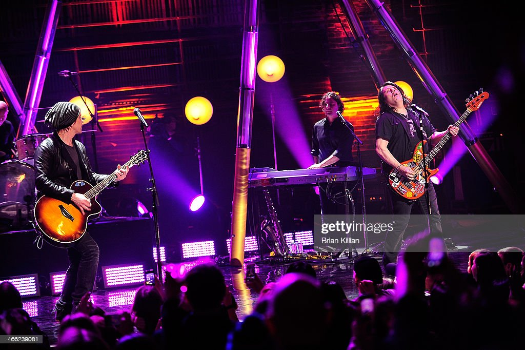 Guitarist Johnny Rzeznik, keyboardist Korel Tunador and bassist Robby Takac of The Goo Goo Dolls perform during VH1's 'Super Bowl Blitz: Six Nights + Six Concerts' at St. George Theatre on January 31, 2014 in the Staten Island borough of New York City.