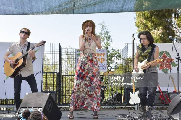Guitarist Jordan Keigher singers Serena Laurel and Dalton Cyr perform onstage at 17th Annual Children's Earth Day Extravaganza at Star Eco Station on...