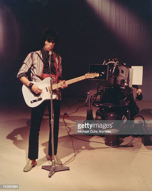 Guitarist Keith Richards of the rock band 'the Rolling Stones' plays a Fender Telecaster electric guitar while performing on the set of a TV show...