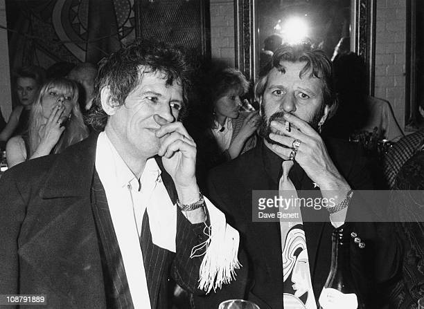 Guitarist Keith Richards of the Rolling Stones at a party with former Beatles drummer Ringo Starr circa 1985