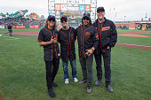 Guitarist Kirk Hammett drummer Lars Ulrich bassist Robert Trujillo and vocalist James Hetfield of Metallica pose for photos before peforming The...