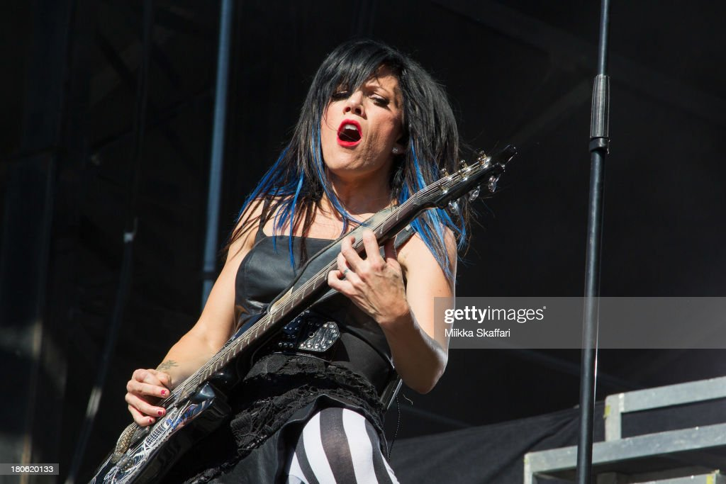 Guitarist <a gi-track='captionPersonalityLinkClicked' href=/galleries/search?phrase=Korey+Cooper&family=editorial&specificpeople=7040698 ng-click='$event.stopPropagation()'>Korey Cooper</a> of Skillet performs in Monster Energy's Aftershock Festival at Discovery Park on September 14, 2013 in Sacramento, California.