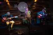 Guitarist Lincoln Parish singer Matthew Shultz and Daniel Tichenor of Cage the Elephant perform during an EndSession hosted by 1077 The End at the...
