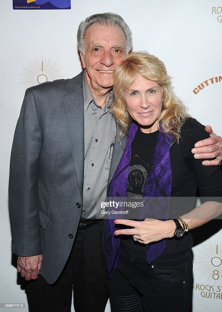 Guitarist Lou Pallo (L) and author and photographer Lisa Johnson attend the book launch and performance for '108 Rock Star Guitars' benefitting The Les Paul Foundation at The Cutting Room on October 8, 2013 in New York City.