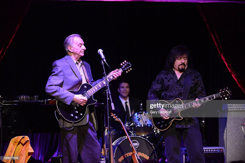 Guitarist Lou Pallo of The Les Paul Trio (L) and Vinny Martell perform on stage for the book launch of '108 Rock Star Guitars' benefitting The Les Paul Foundation at The Cutting Room on October 8, 2013 in New York City.